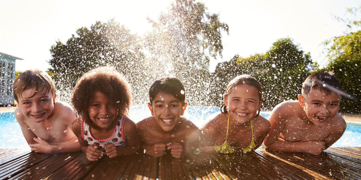 Happy Children in Outdoor Swimming Pool - Updates to the Texas Pool Code | NSF International