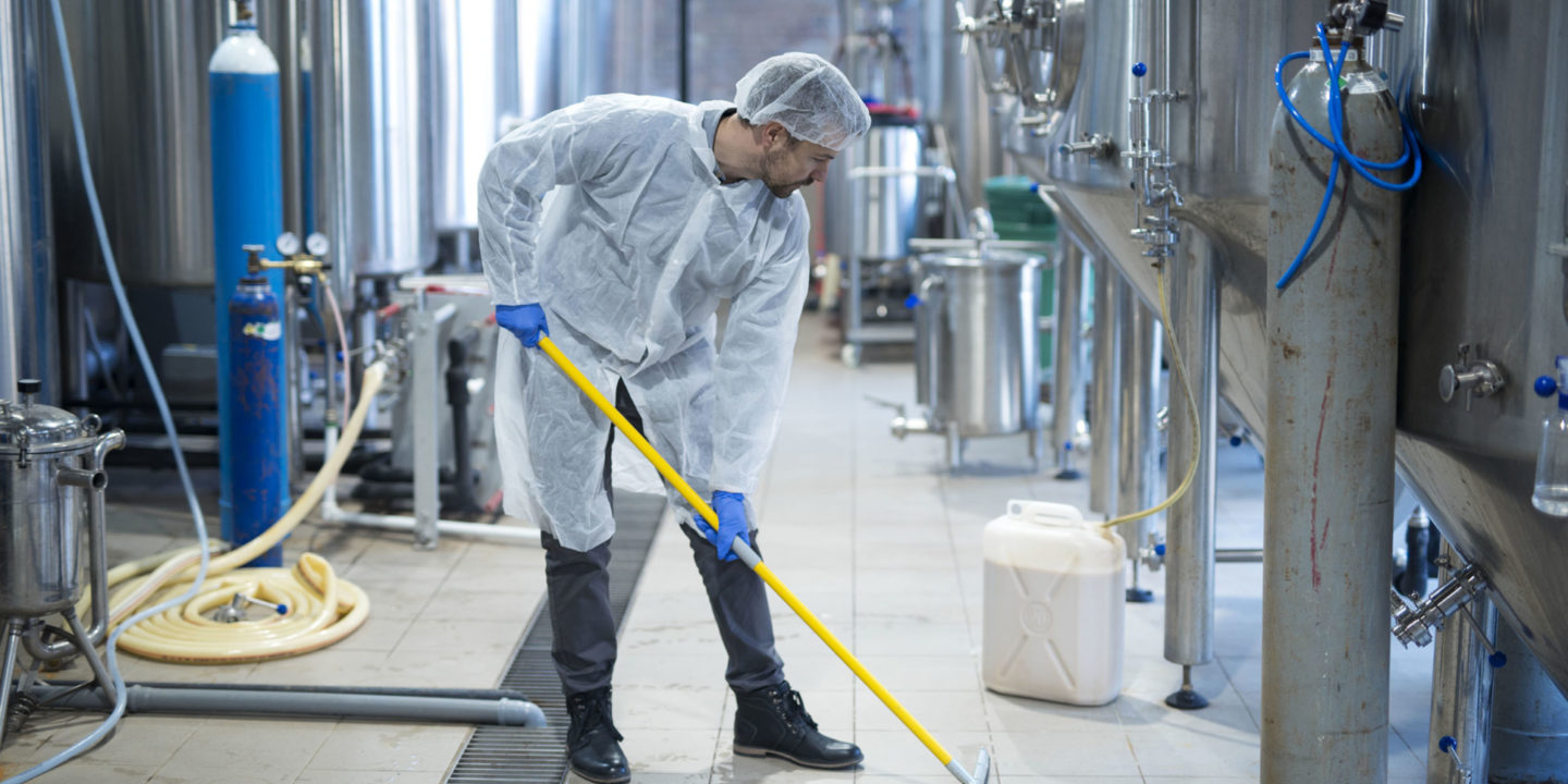 Man cleaning production facility floor | NSF International