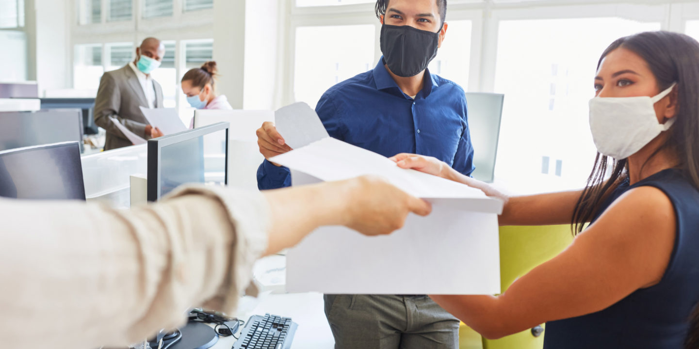 People training with masks in office
