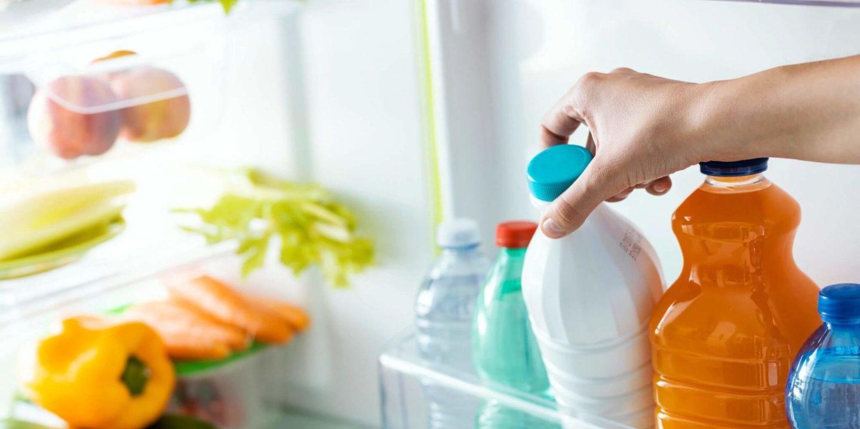 Picking up milk carton from open fridge