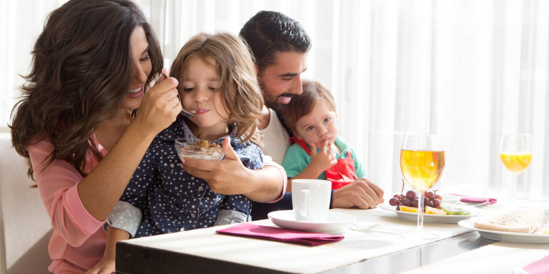 Parents feeding children - Food Safety   NSF International