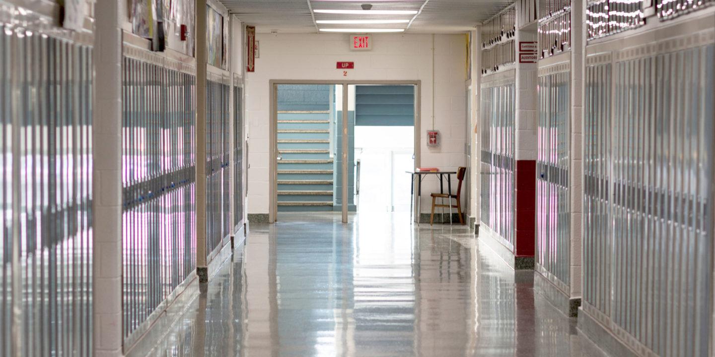 Empty school hallway with lockers