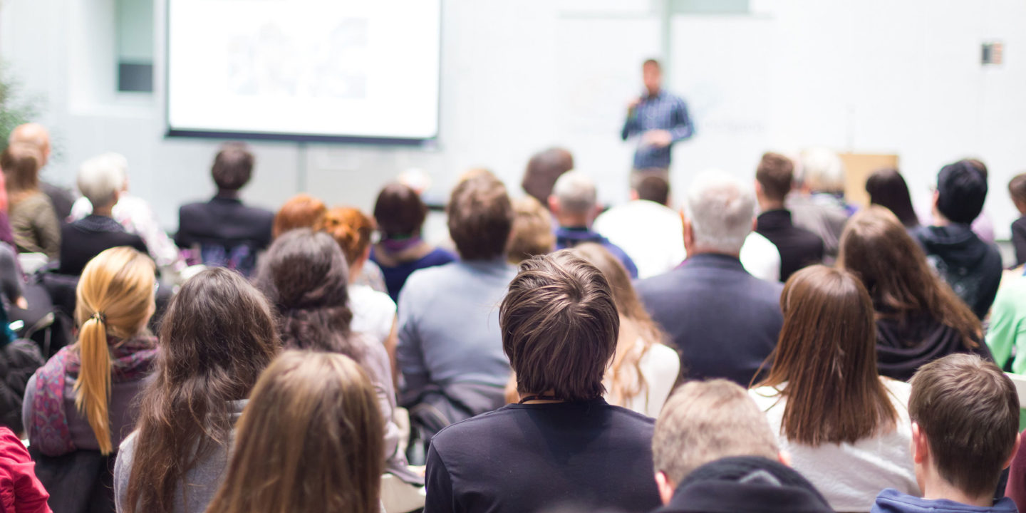 Speaker talking at a business conference - Academia | NSF International