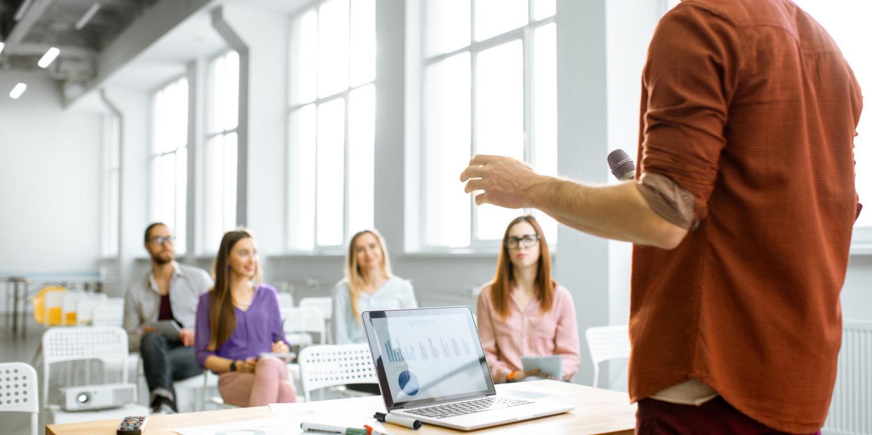 Speaker in front of class