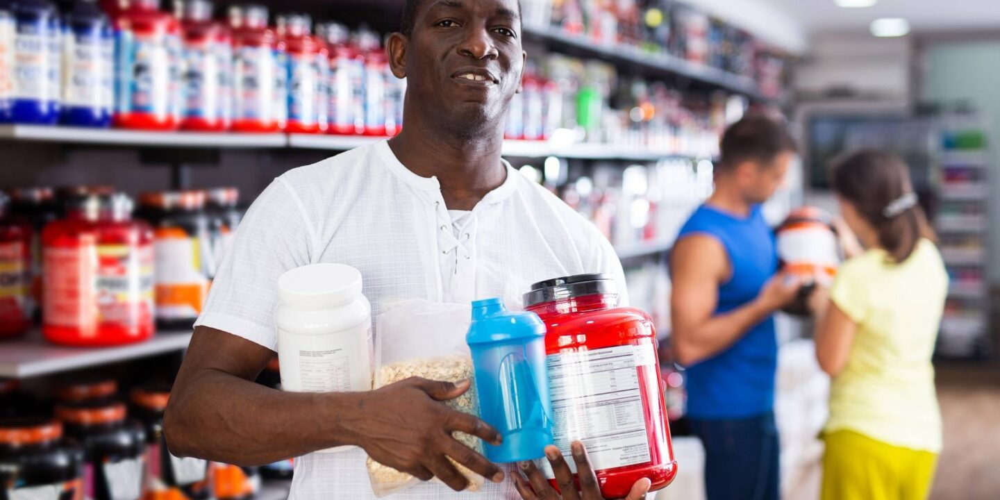 A man with sport nutrition products - Beware of Banned Substances in Sports Supplements   NSF International