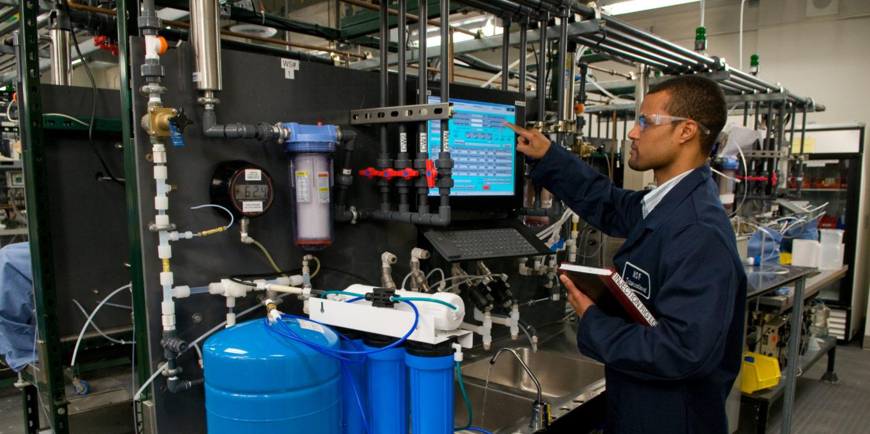 NSF International lab technician testing drinking water