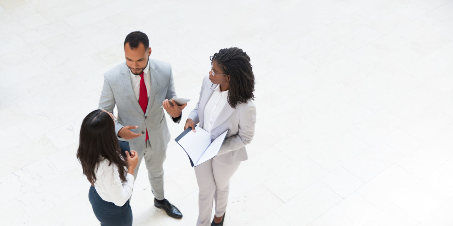 Three Business People Talking - Water Consulting Services | NSF International