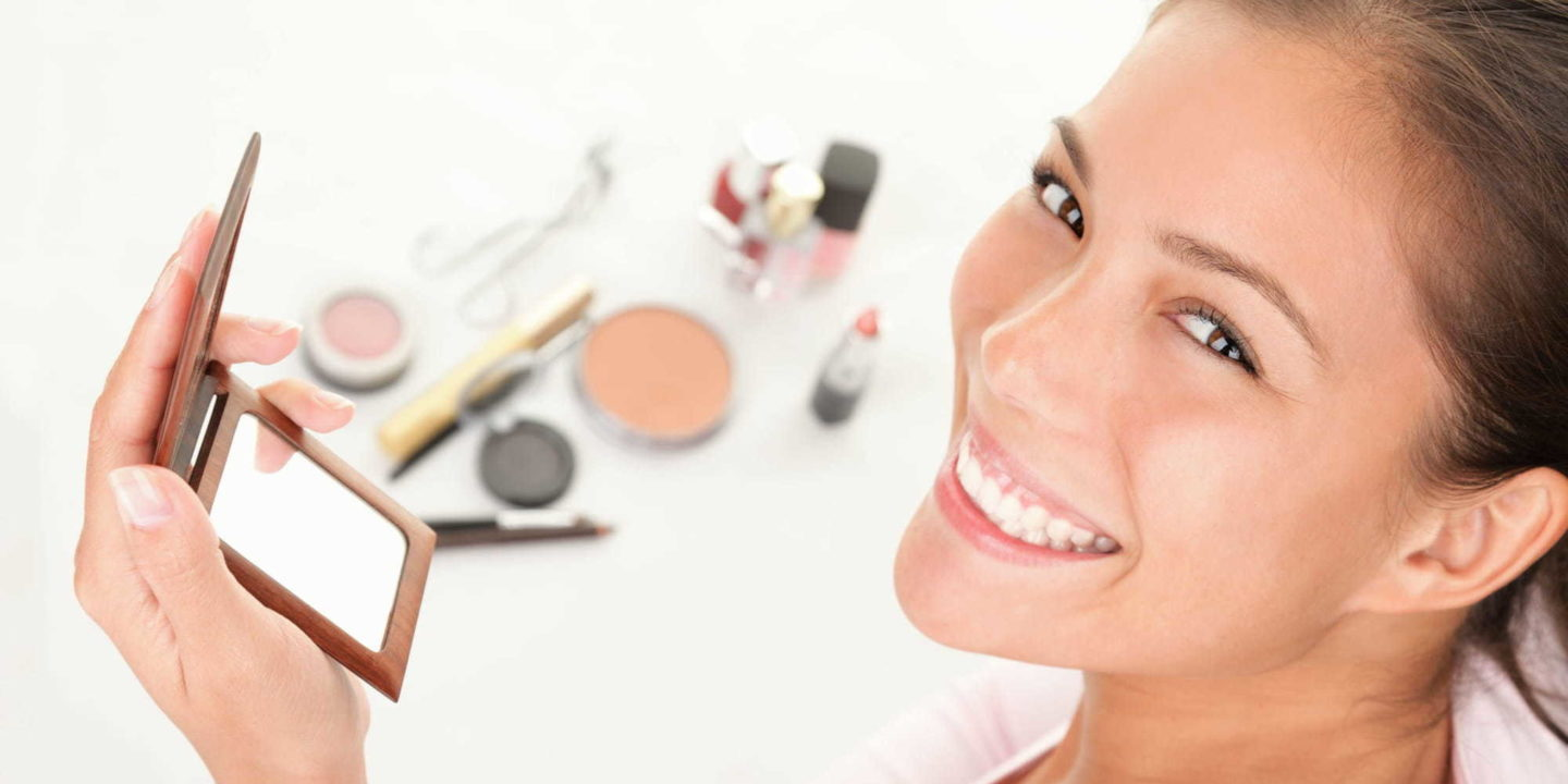 Women having fun with make-up products - Unmasking Beauty Tips to Safely Get Your Makeup on Again   NSF International