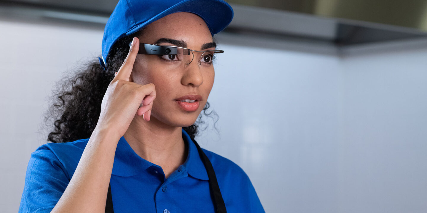 Woman wearing EyeSucceed Glasses - Augmented Intelligence and Smart Glasses Technology | NSF International