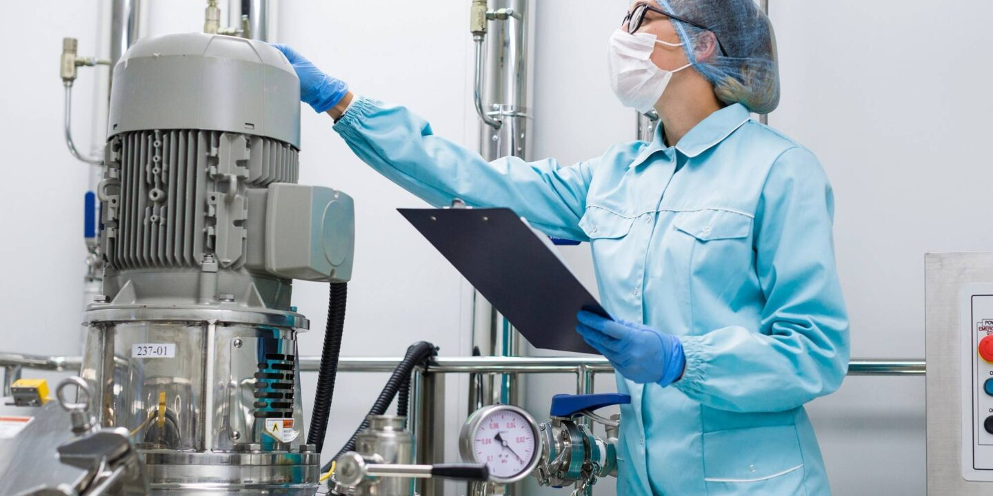 Woman factory worker overseeing pill production - Need for GMP Remediation Program   NSF International