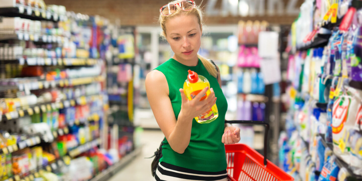 A woman shopping for cleaning products at supermarket - Safer Choice Label For Cleaning Products | NSF International