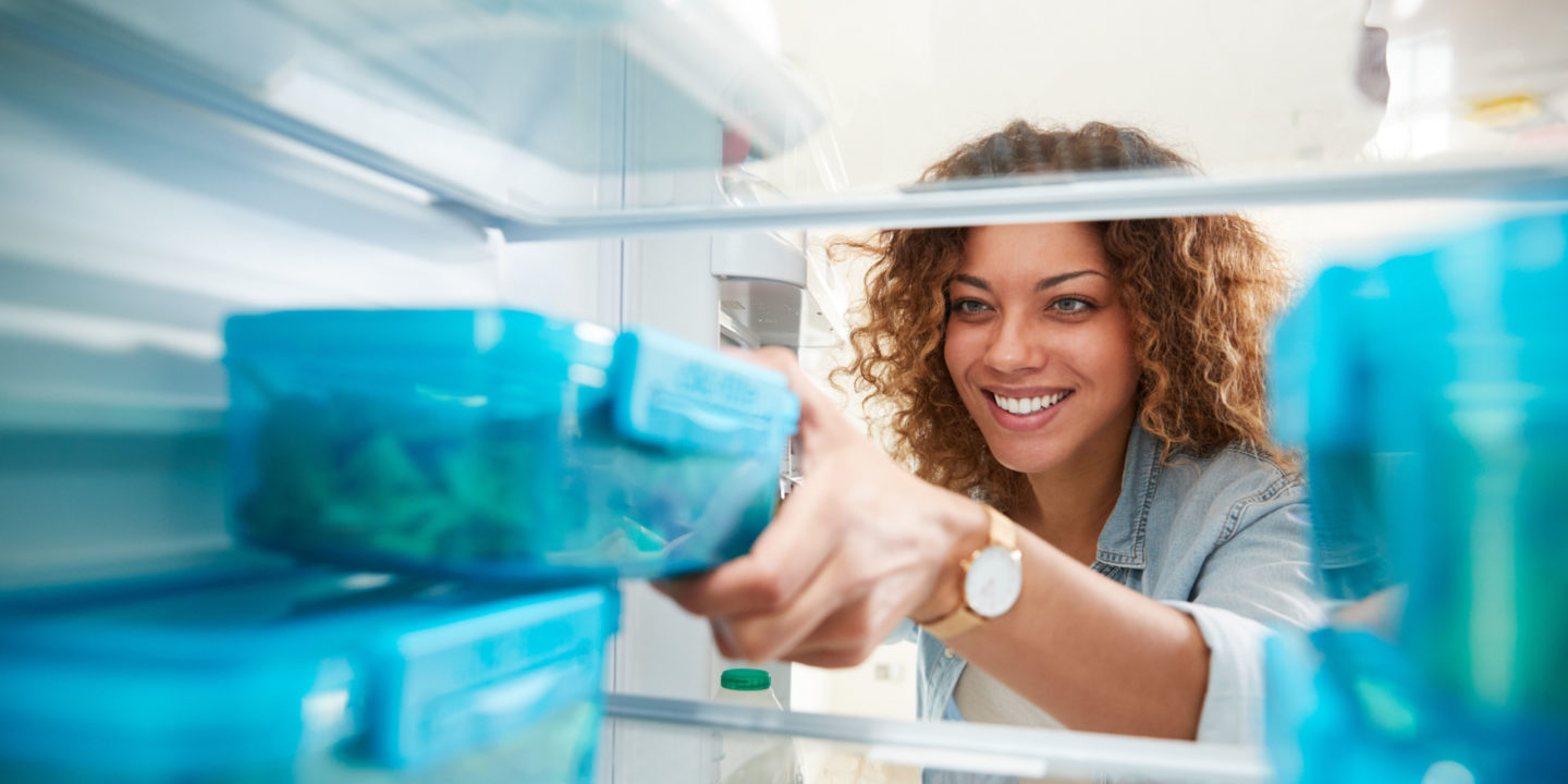 Woman removing ingredients from refrigerator - Cooking   NSF International