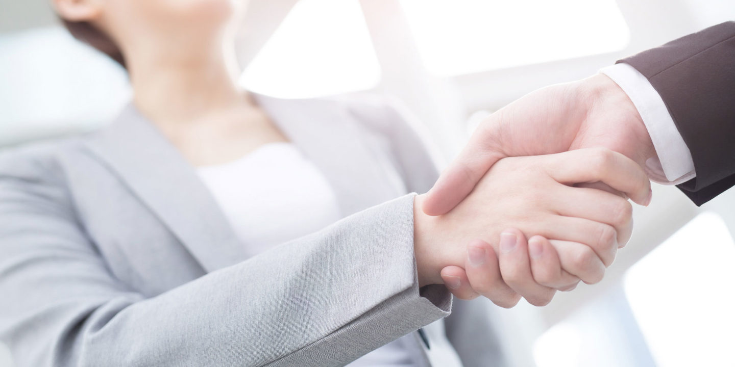 A female company manager shaking hands with her colleague - Remediation of Pharmaceutical Quality Systems   NSF International