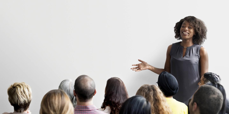 Woman talking to crowd