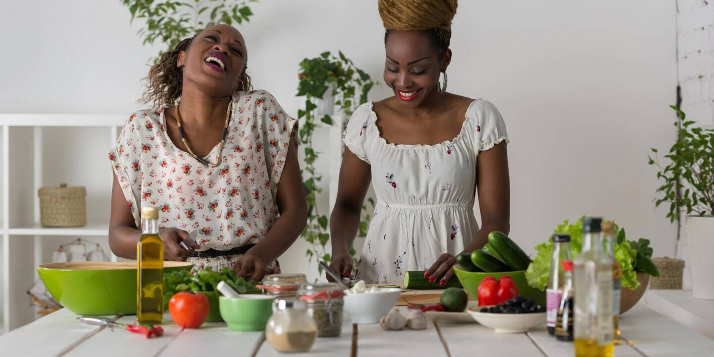 Two women cooking in kitchen making healthy food-Top 5 Cooking Safety Tips for Home Kitchen   NSF International