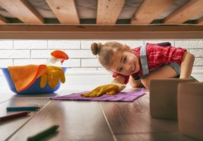 Child wiping floor under bed - Get Your Home Ready for Spring With These Deep Cleaning Tips | NSF International