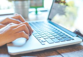 Laptop on table - NSF is approved for Amazon Supplement Sales Rules | NSF International