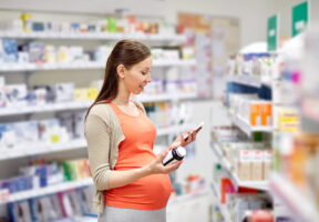 Pregnant woman reading supplement label - New Study: Most Americans Hold Retailers Responsible for Quality and Safety of Health and Wellness Products | NSF International