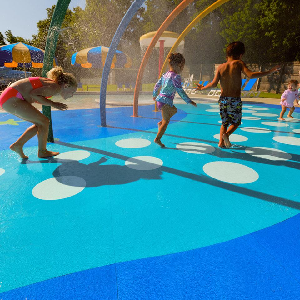 Kids playing at water park