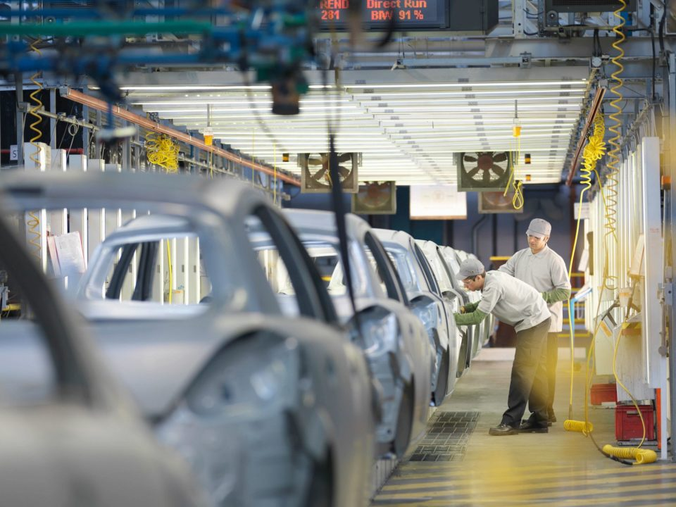 Men working on autofactory line - IATF 16949 Automotive Quality Management Systems