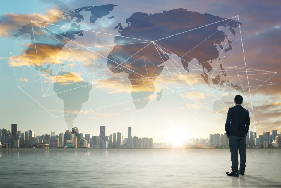 Businessman on city skyline background with network on map and sunlight
