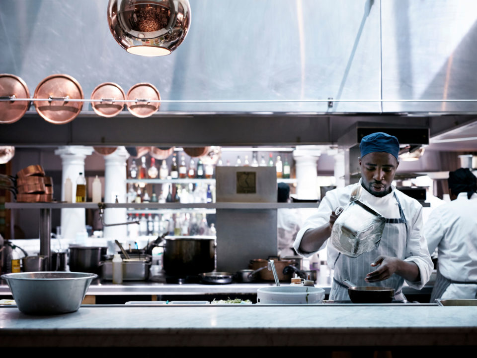 Chef cooking in the kitchen of fine restaurant