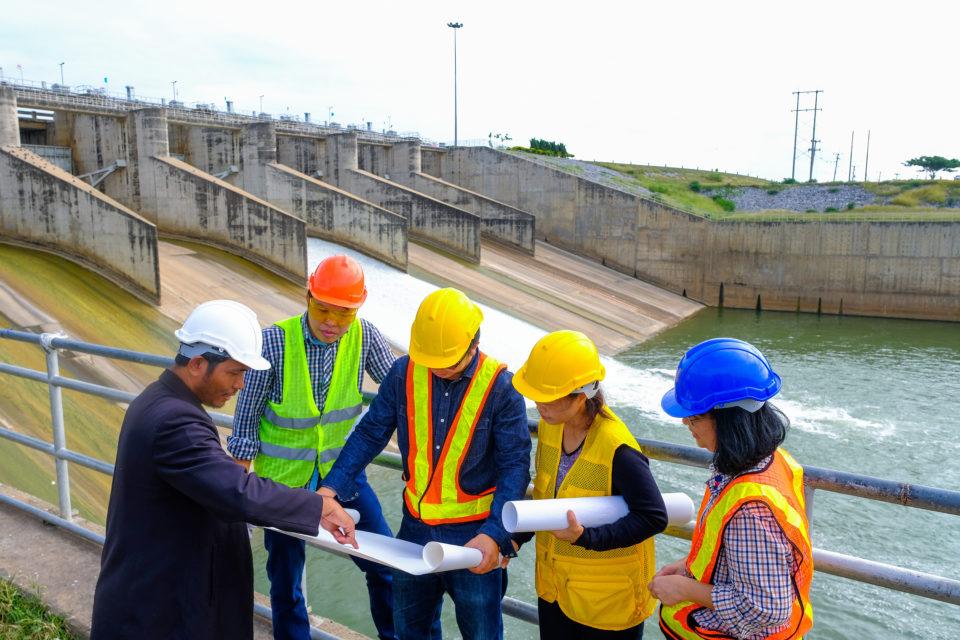 Construction crew reviewing plans