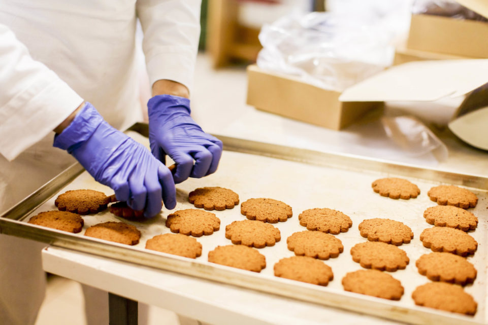Fresh baked cookies being packaged in commercial kitchen