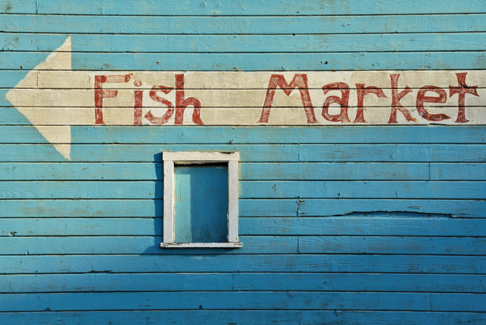Fish market sign on side of building