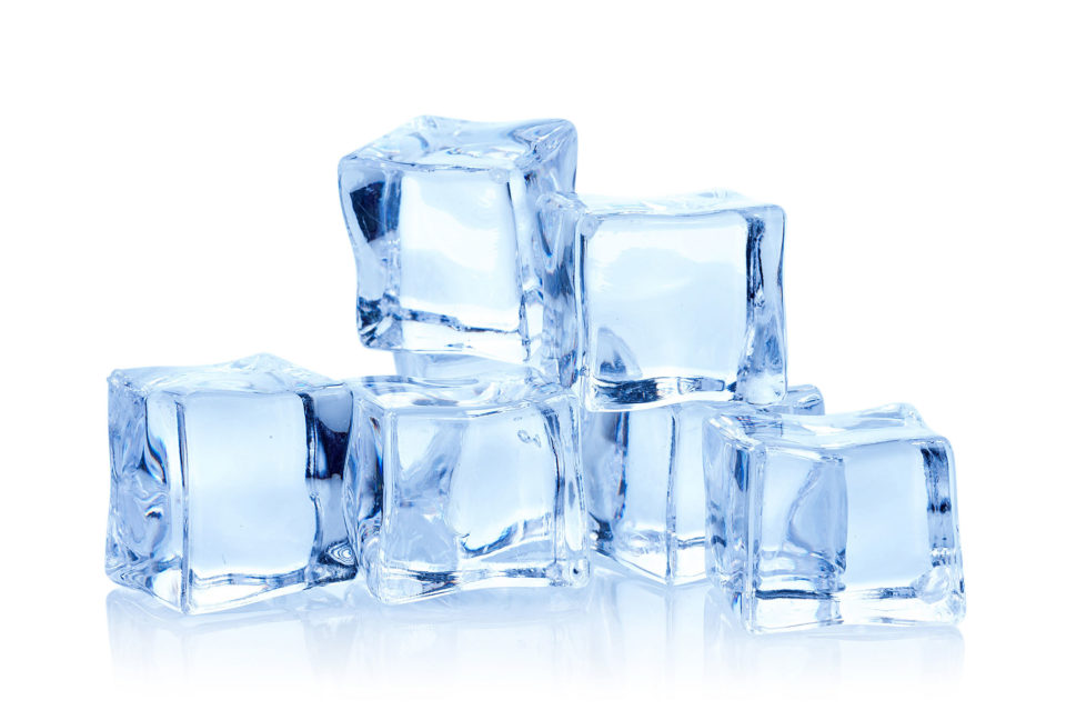 Close-up of ice cubes against white background