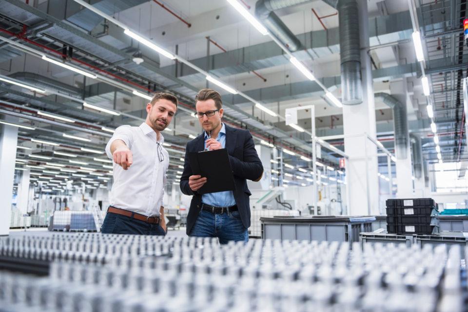 Two men talking in factory shop floor