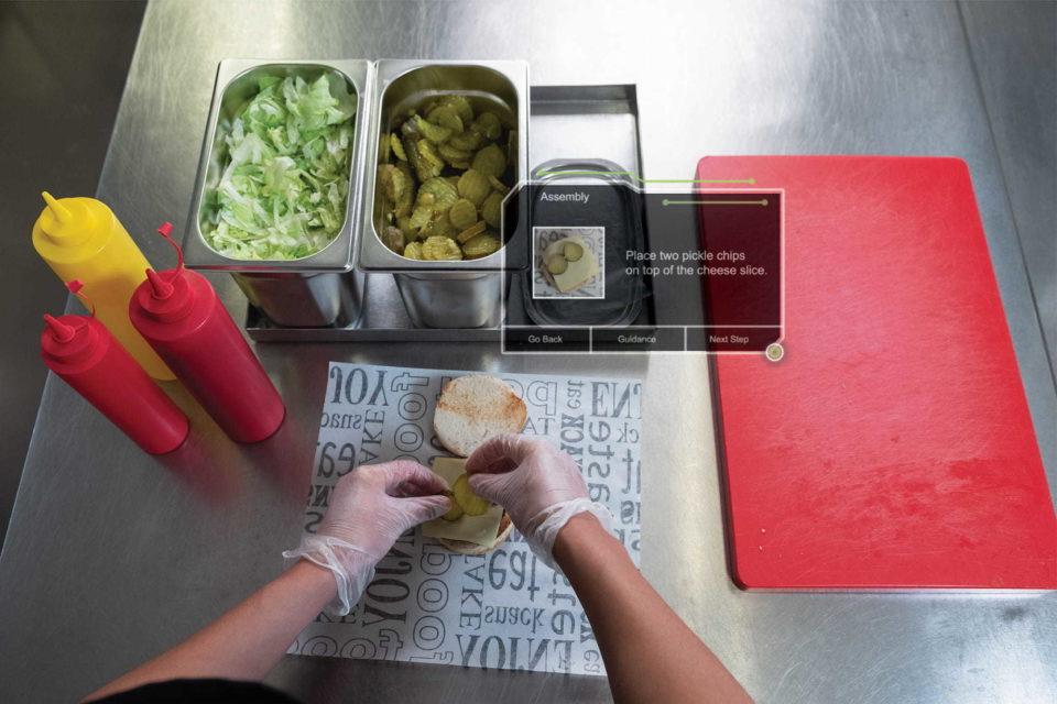 Restaurant working assembling hamburger wearing smartglass - Enhanced Training and Wearable Learning   NSF International