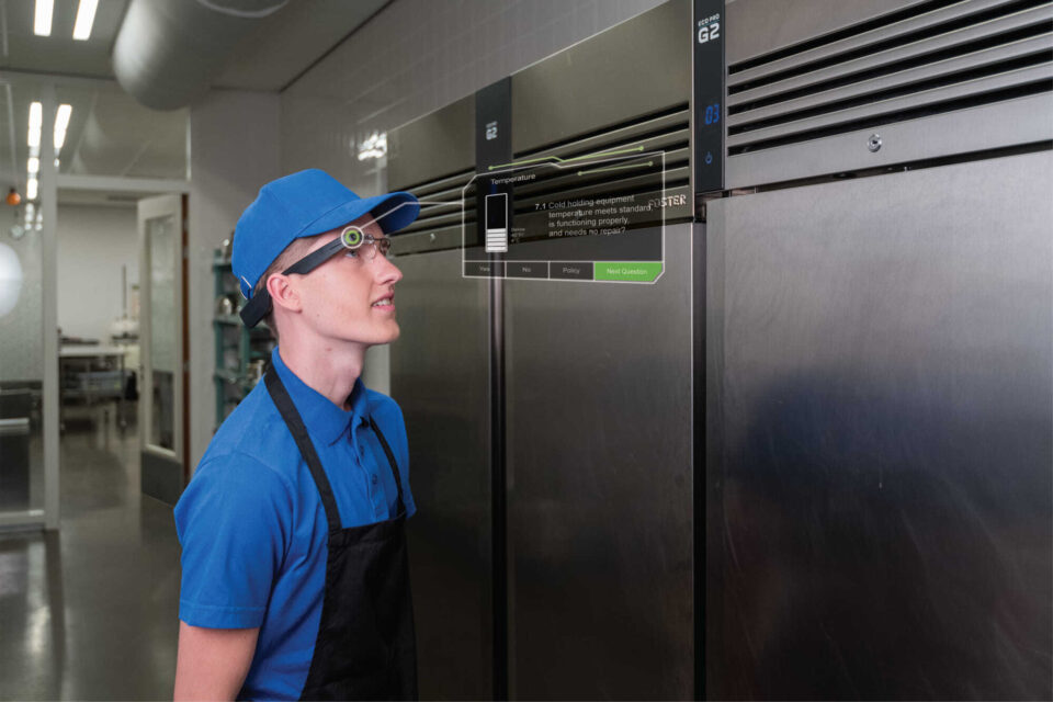 Restaurant worker checking equipment with smartglass - Checklists, Self-Audits and Inventory Management   NSF International