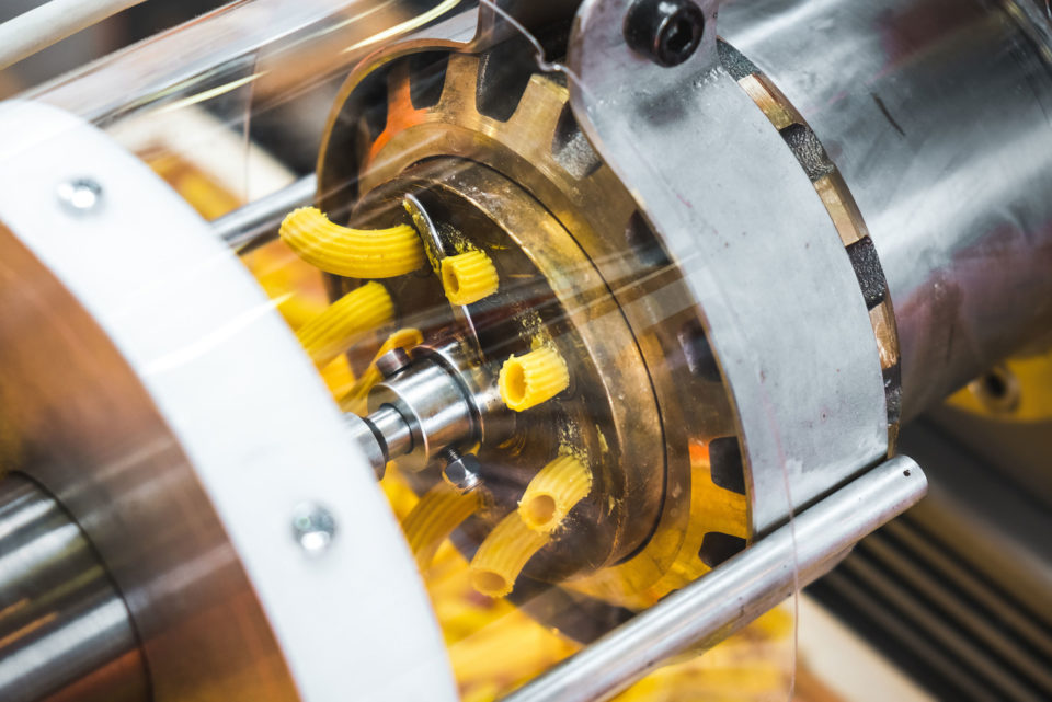 Machine creating pasta at a factory