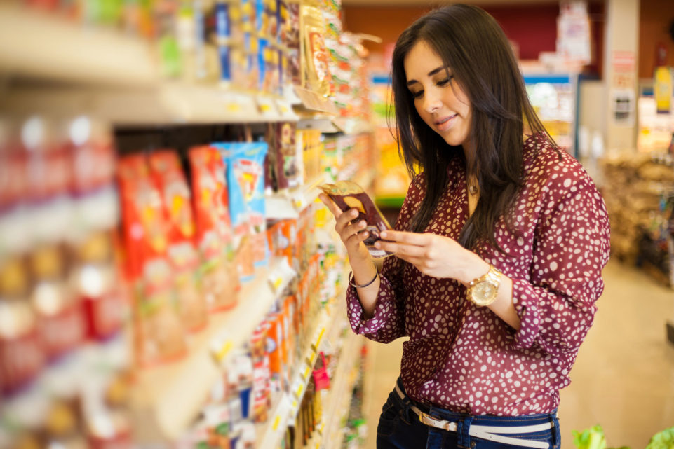 Woman reading a product label - Food Labeling and Specifications Management Consulting Services