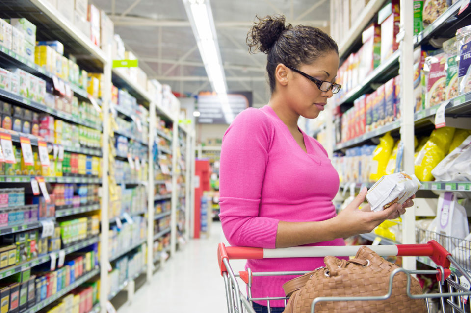 Woman shopping for groceries - Non-GMO Project Verification
