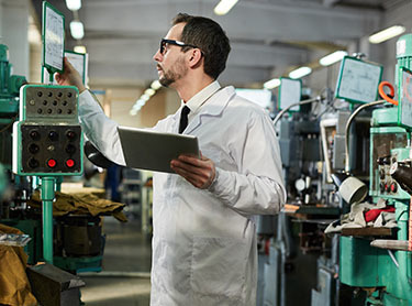 Man reviewing screen in factory