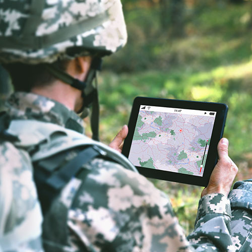 Military soldier using map on tablet in the forest - CMMC Overview Program for DoD   NSF-ISR